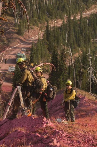 Firefighters on the Rice Ridge Fire keep a watch for spot fires.
