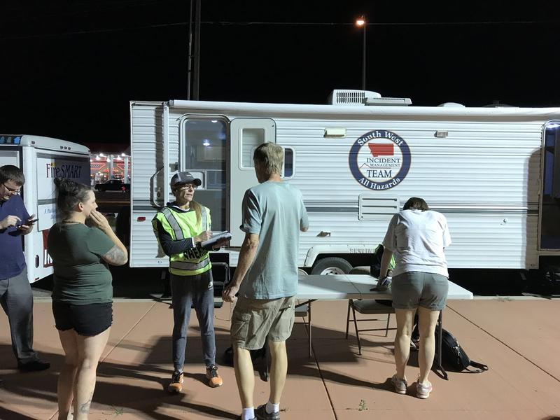 Evacuees check in with Missoula County Sheriff's Department Staff in Lolo Wednesday night