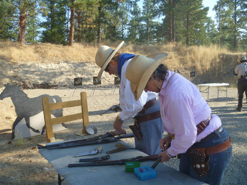 """""""Steveareno"""" and """"Lady Jane"""" load their guns during an action shooting event in Hamilton, MT Sept. 3, 2017."""