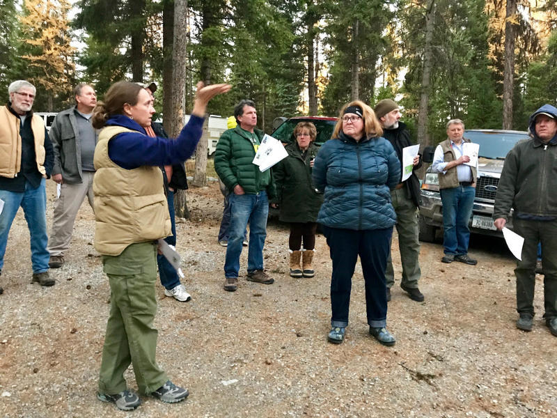 Ali Ulwelling from the Montana DNRC guides Whitefish-area homeowners through the process of assessing a home for fire preparedness.