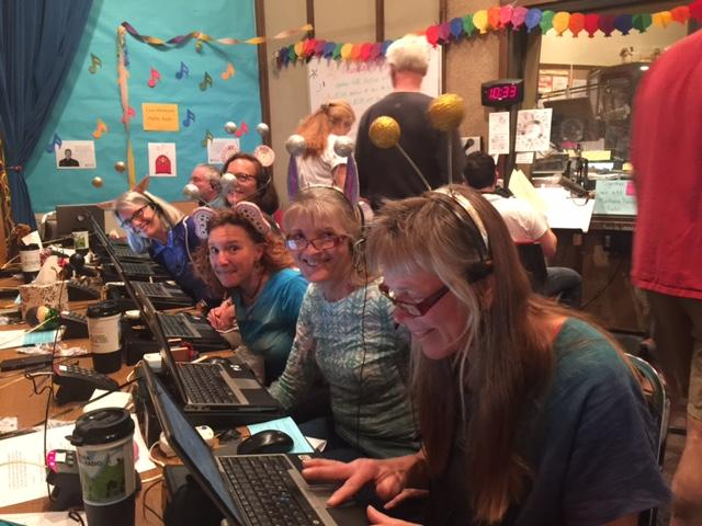 Volunteers having a fun while answering phones during pledge week.
