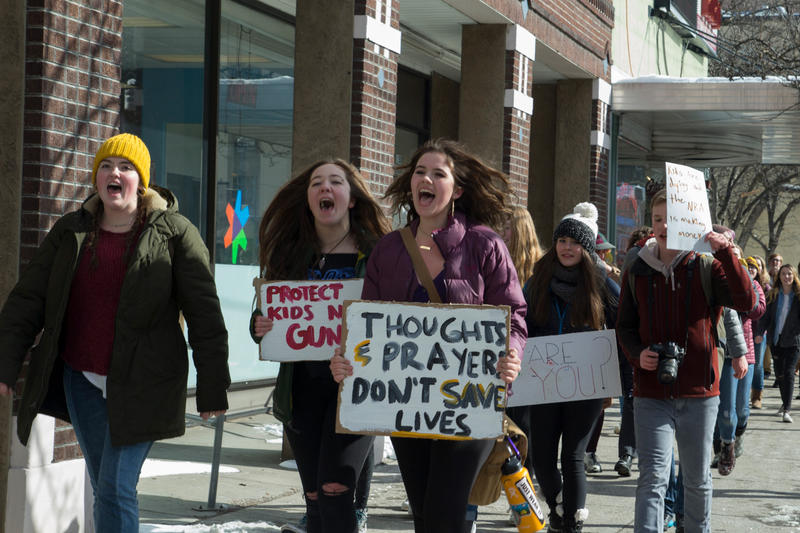High school students march in downtown Missoula February 21, 2018, after walking out of classes to call for stronger gun regulation.