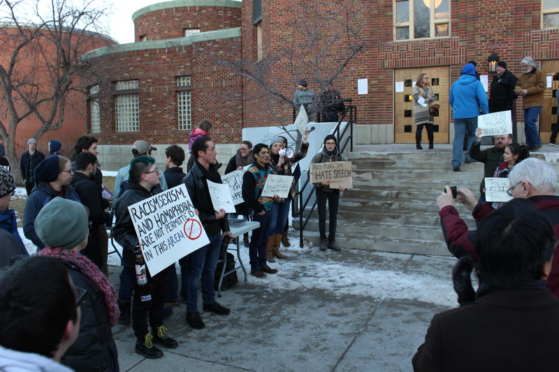 Protesters gathered outside of the Jeff Cole Distinguished Lecture at the University of Montana on Tuesday night.
