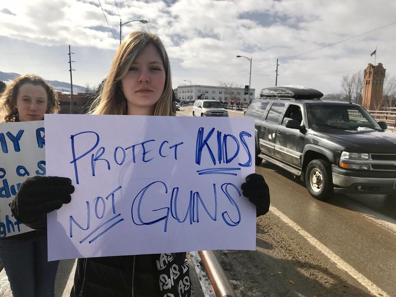 A student holds a sign reading Protect kids not guns, during a student protest in Missoula Februay 21, 2018.