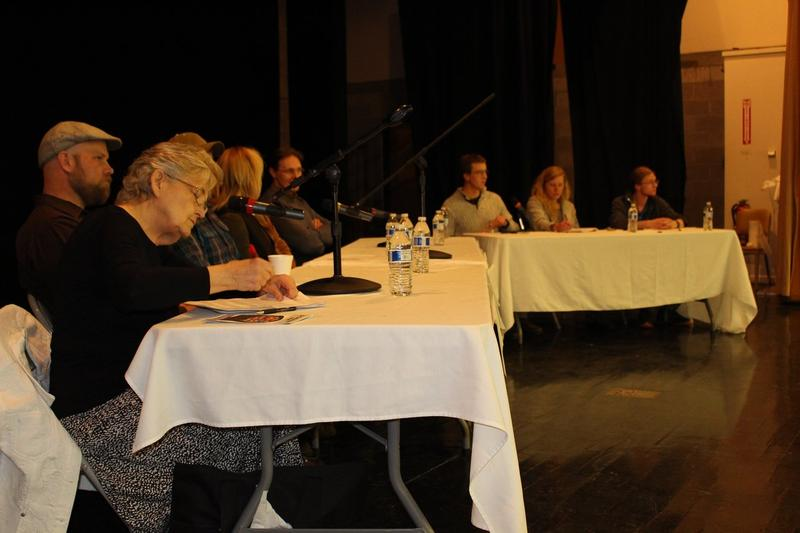 Six panelists and three moderators at Montana Tech for the KBMF public forum on Superfund. L-R: Mary Kay Craig, David Hutchins, Eric Hassler, Rayelynn Brandl, Robert Pal, Daniel Hogan, Olivia Everett, Leif Clark. (Not pictured: Pat Cunneen)