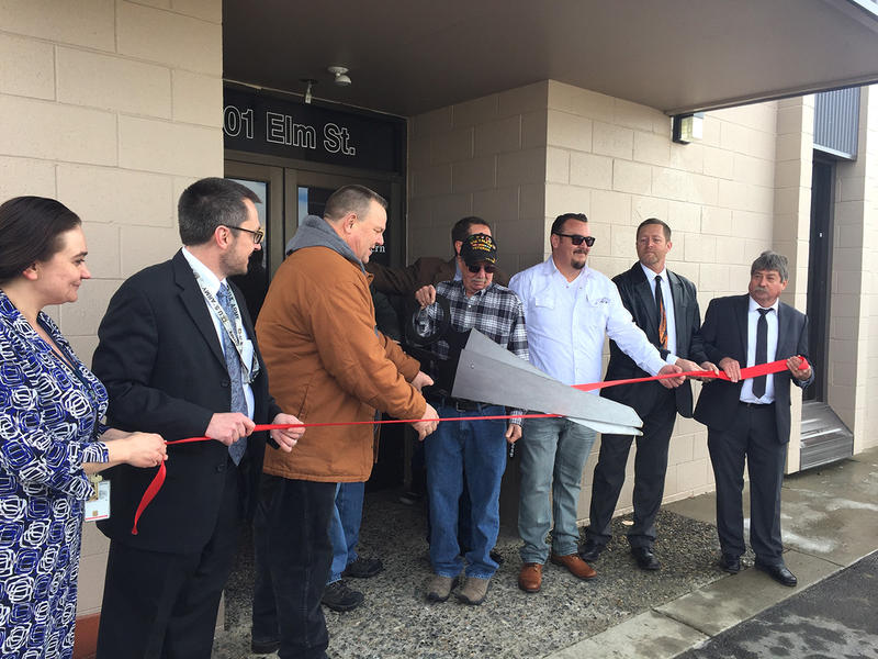 Senator Jon Tester, Helena Veteran Center staff, and local veterans, pose for ribbon cutting at the center's opening ceremony, Friday March 9, 2018 in Helena.