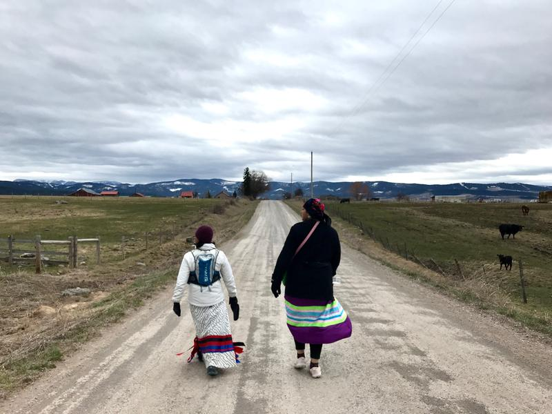 Marita Growing Thunder (right) walks along Hillside Rd in honor  of missing and murdered indigenous women on March 27. Tuesday was day three of a four day 80 mile walk.