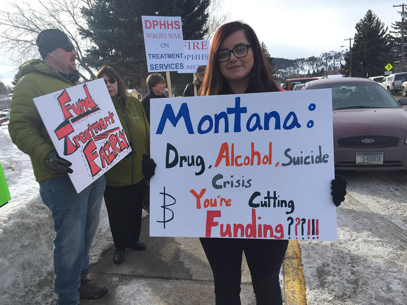 Jennifer Munger holds a sign protesting state health deparment cuts in Helena, March 1, 2018. Munger says she's recently sober and want's other people with substance abuse issues to be able to get the same treatment she had.