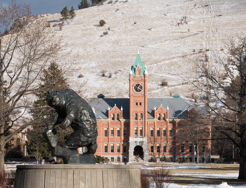 Grizzly statue and Main Hall on the University of Montana campus in Missoula.