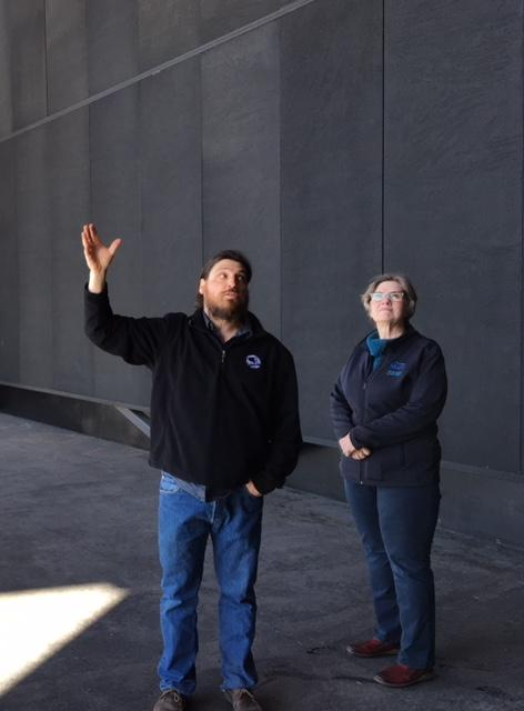 Missoula County Commissioner Jean Curtiss (R) with Nick Checota of Logjam Presents during a Curtiss campaign stop at the KettleHouse Amphitheater in Bonner, MT, March 12, 2018. The amphitheater is built on the site of a closed timber mill.