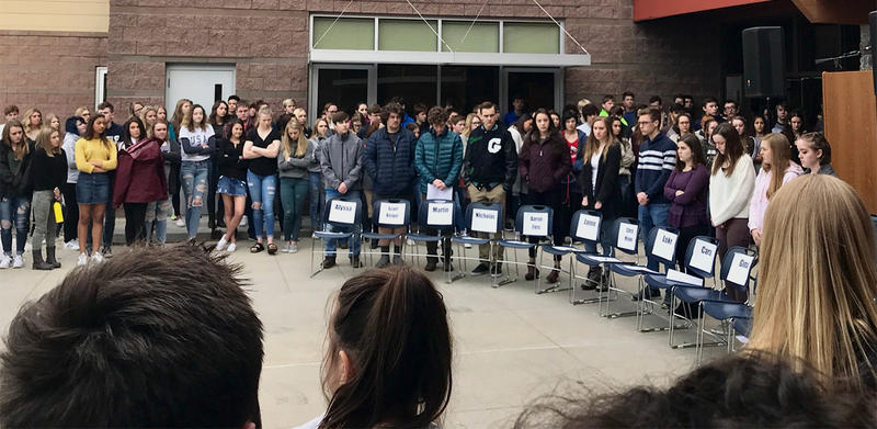 Students at Glacier High School in Kalispell, MT memorialized the Parkland shooting victims on March 14, 2018 by placing 17 empty chairs outside, one for each of the victims.