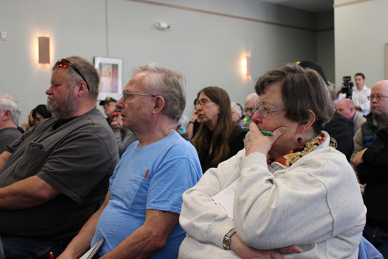 Community members listen to updates on Butte Superfund issues from EPA officials at the Butte public archives April 11, 2018.