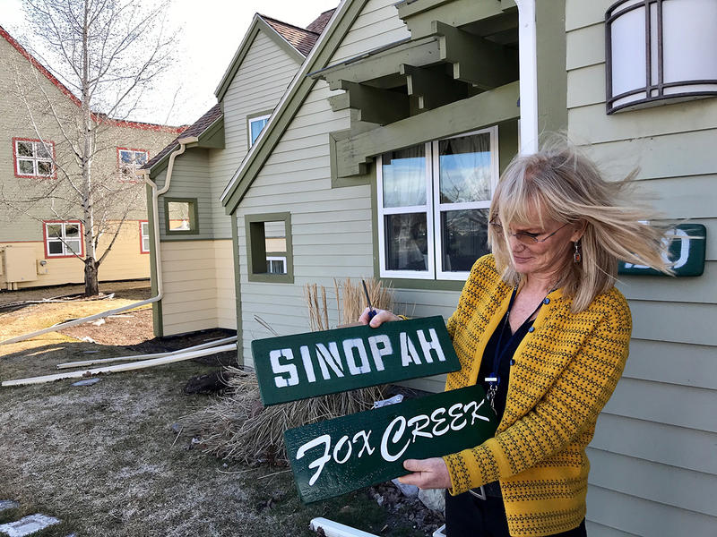 Paula Buckley swaps out signs at the former Sinopah House in Kalispell, Friday, March 30, 2018. The therapeutic girls' group home is being turned into a home for adults with developmental disabilities.