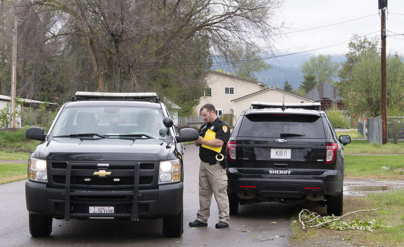 Missoula County Sheriff deputies go door to door warning residents of Keck Street in Missoula to be prepared to evacuate, May 7, 2018.