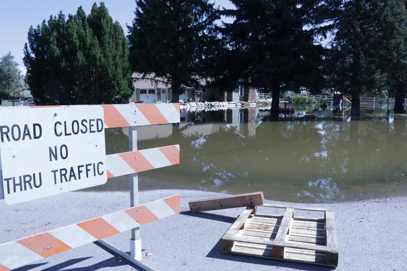 A road closed sign in a flooded Missoula neighborhood, May 12, 2018.