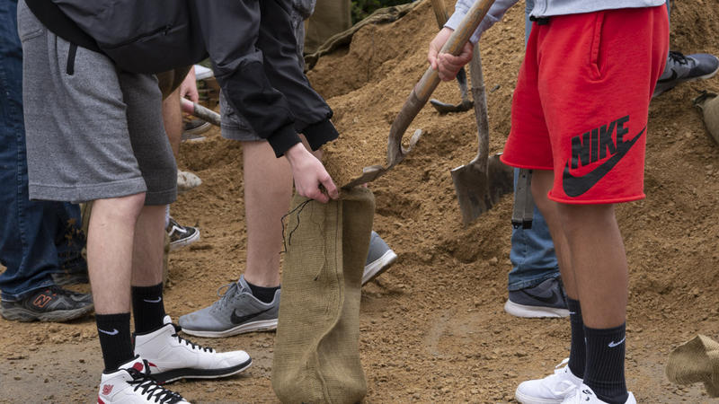 Students fill sandbags in Missoula's flooded Orchard Homes area, Monday, May 7, 2018.