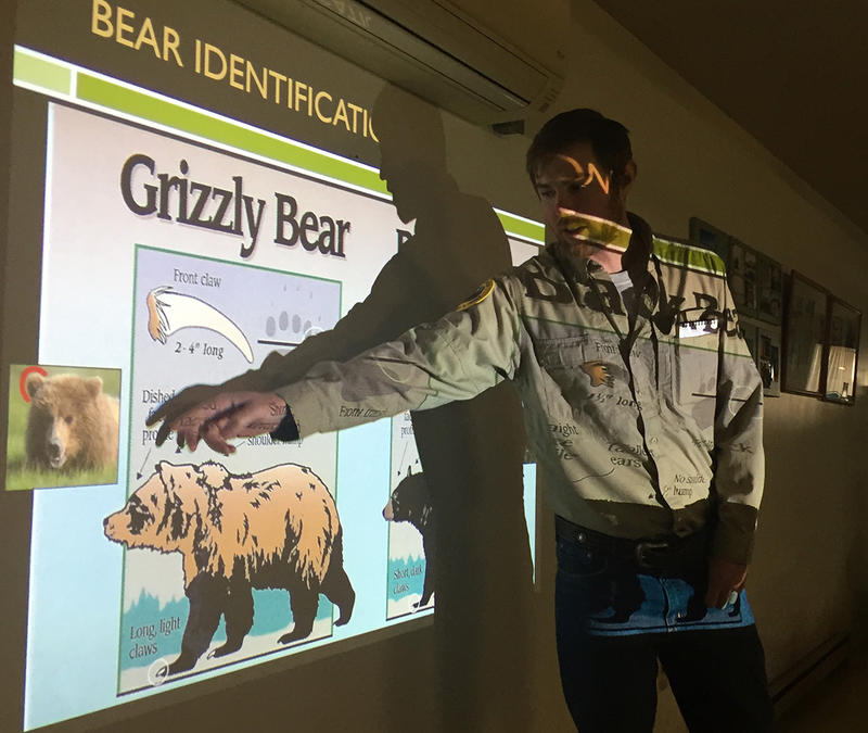 Bear Management Specialist Wesley Sarmento runs through basic bear identification during a community meeting in Fort Shaw, MT, April 4, 2018. Sarmento and other bear managers are preparing locals for more grizzlies moving into the area.