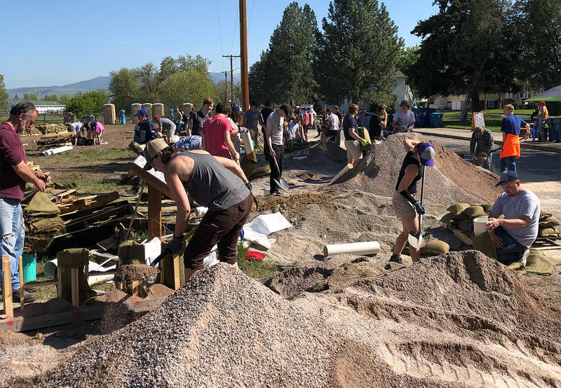 Volunteers fill sandbags at Fort Missoula, May 15, 2018 in Missoula, MT.