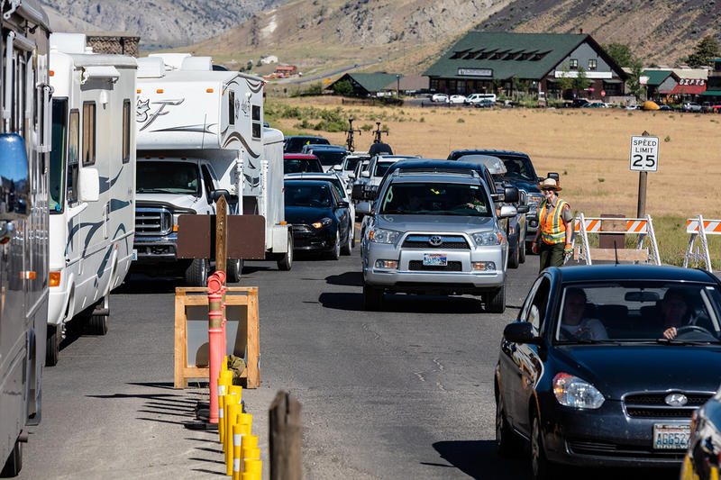 Yellowstone visitors line up at the park's north entrance outside of Gardiner, MT.