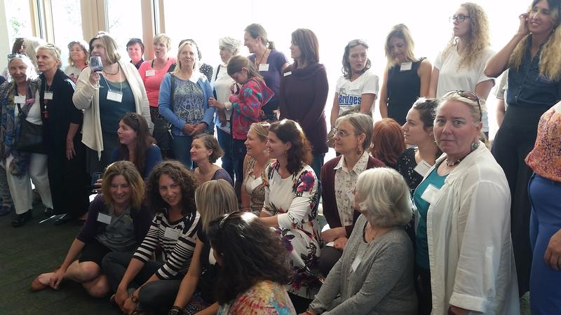 Attendees at the kick-off event gather for a group photo after learning about the Women's Giving Circle.