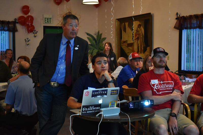 Candidate Albert Olszewski and campaign manager Joey Chester watch primary election results in Somers on June 5.