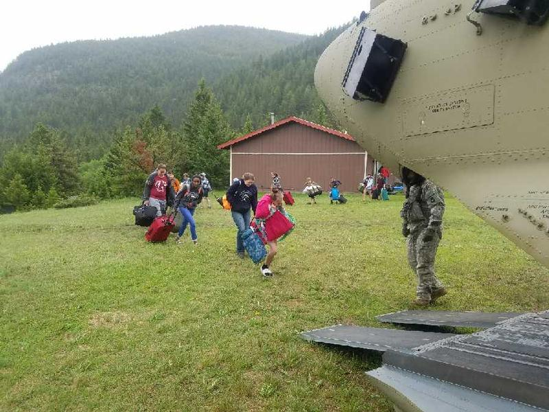 Nearly 140 teens and adults are evacuated via helicopter from a bible camp near Augusta, MT, June 21, 2018.