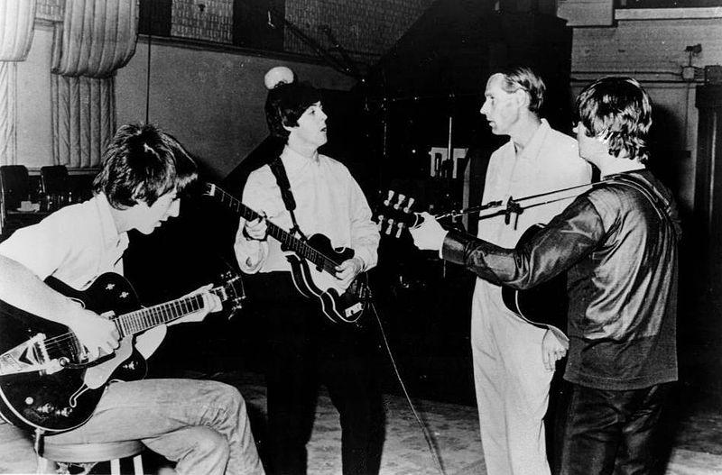 A 1965 publicity photo of  John Lennon, George Harrison and Paul McCartney of the Beatles with producer George Martin in the studio at Abbey Road.