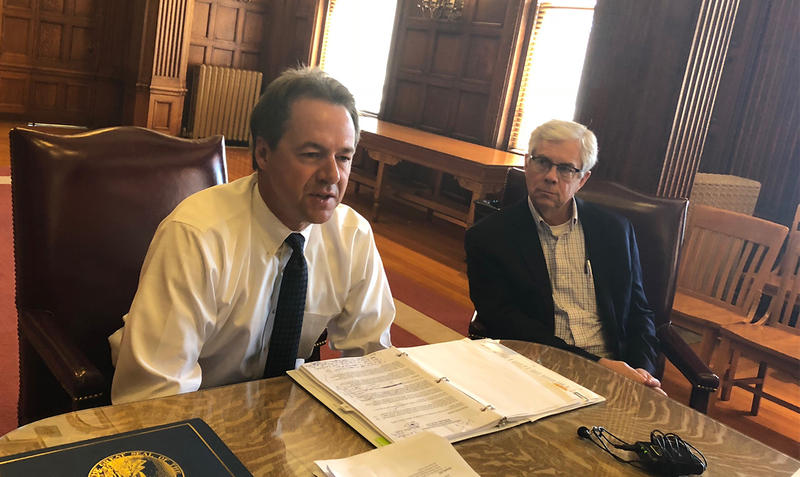 Montana Governor Steve Bullock and Lieutenant Governor Mike Cooney talk with reporters in the Capitol about restoring funding for some state budget cuts, July 25, 2018.