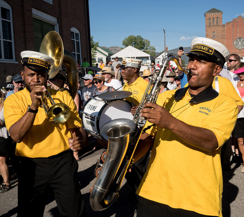 Treme Brass Band leads a parade at the opening of the Montana Folk Festival in Butte, July 13, 2018.