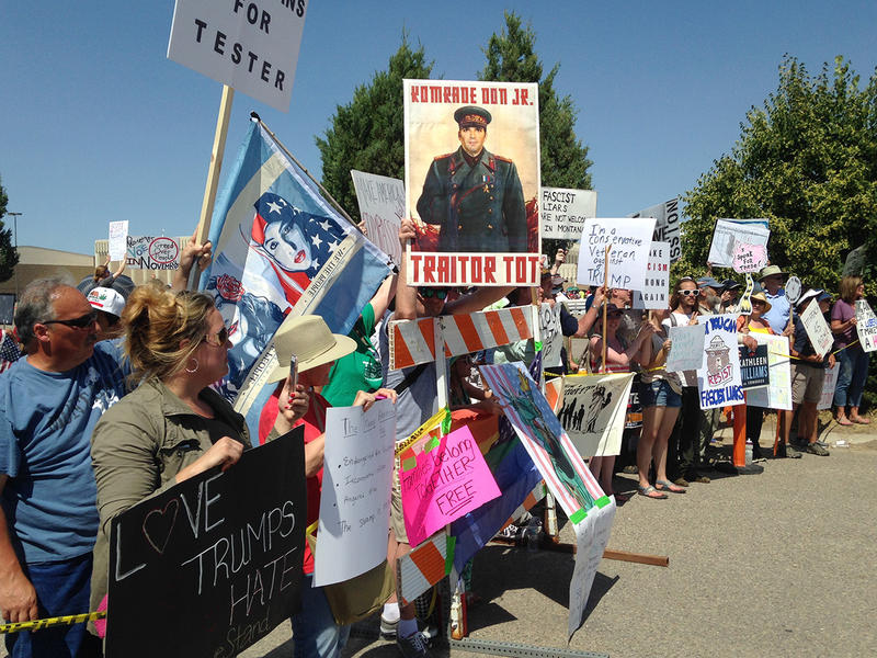 Protesters line up outside a Trump campaign rally in Great Falls, MT, July 5, 2018.