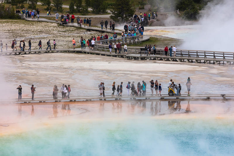 Tourists at Yellowstone Park's Grand Prismatic Spring.