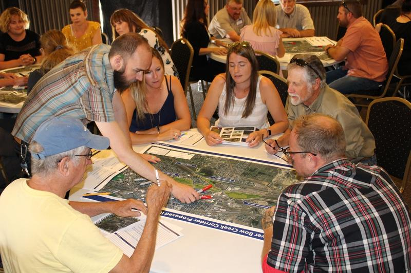 Jeremy Grotbo, with Butte-Silver Bow County, points to a trail feature on a map of Silver Bow and Blacktail Creek corridors in Butte at the Community Design Workshop. August 7, 2018.