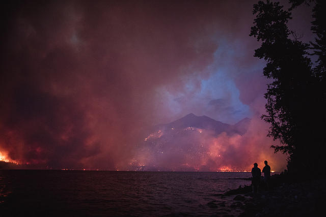 The Howe Ridge Fire seen from across Lake McDonald on the night of August 12th, roughly 24 hours after the fire was started by a lightning strike in an area previously burned in the 2003 Roberts Fire.