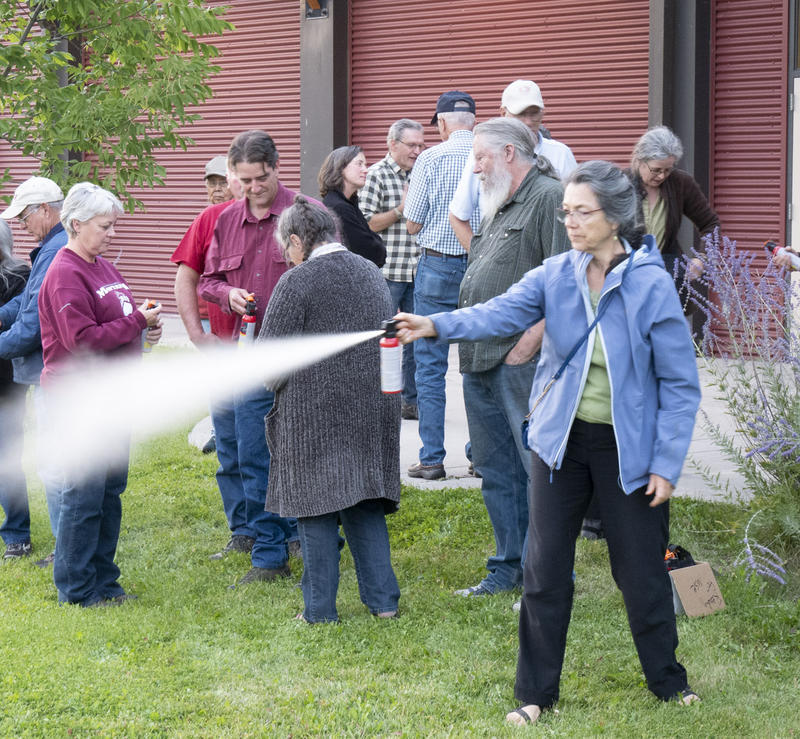 Practicing with a test can of bear spray at a grizzly bear meeting in Arlee, MT, August 28, 2018.
