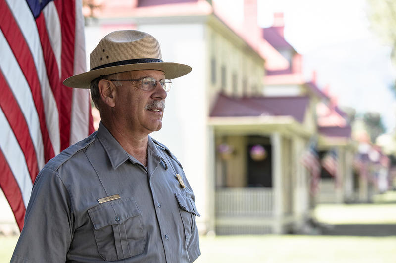 Yellowstone Park Superintendent Dan Wenk on the front step of the superintendent's residence in Yellowstone.