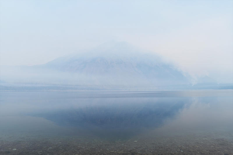 The view toward Glacier Park's Stanton Mountain obscured by smoke, with Lake McDonald in the foreground, August 21, 2018.