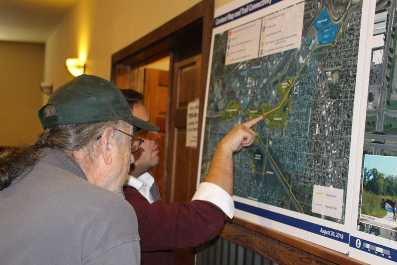 Evan Barrett, a member of Butte's local Restore Our Creek Coalition, looks at plans for the creek corridors with state budget director Dan Villa. August 30, 2018.