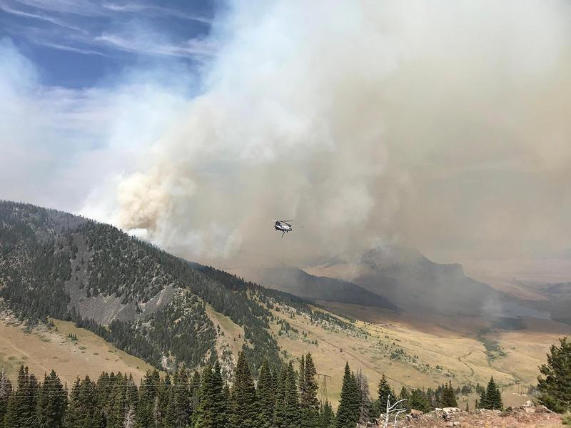 A helicopter flies near the Shellrock Fire NE of Helena Montana, August 15, 2018.