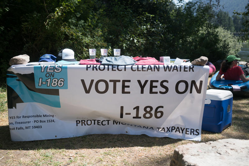 "A sign at the ""Rally for Our Rivers,"" an event in support of ballot initiative I-186"