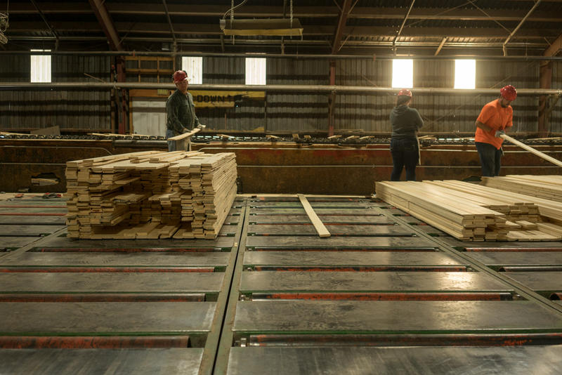 Workers sorting lumber at Pyramid