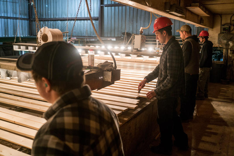 Workers on the line at Pyramid Mountain Lumber Company