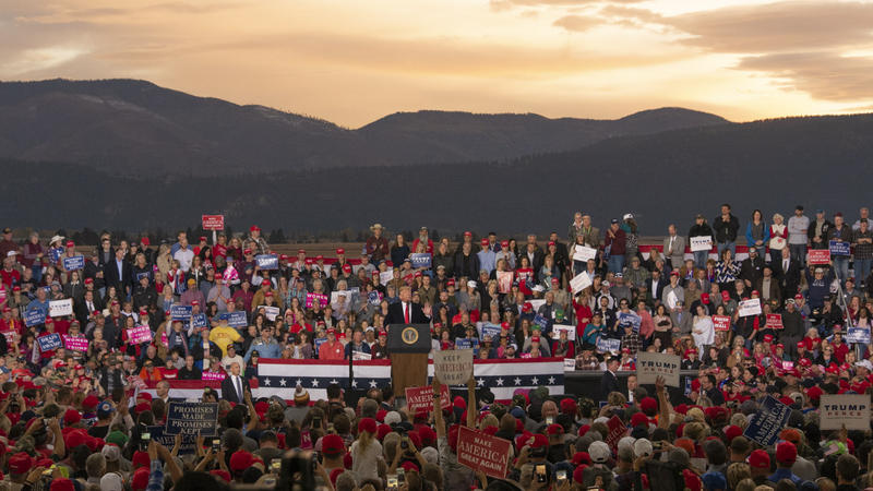 President Trump on stage at a Missoula campaign rally as the sun sets over the Bitterroot Mountains, Oct. 18, 2018.
