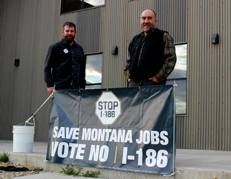 Jeremy Fleege (L), an environmental engineer with Montana Resources, and Matt Vincent (R), an environmental consultant for MR, at a Stop I-186 event at Butte Brewing Company, October 24, 2018.