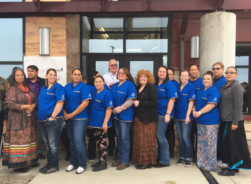 Blackfeet Community College faculty, staff and nursing students stand in front of the new $7.5 million building.