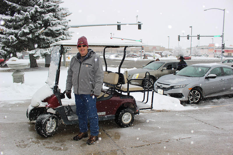 Carter Anderson was helping transport voters to and from the Butte Civic Center in the golf cart, Nov. 6, 2018.