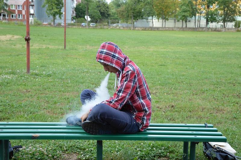 Man using an e-cigarette.