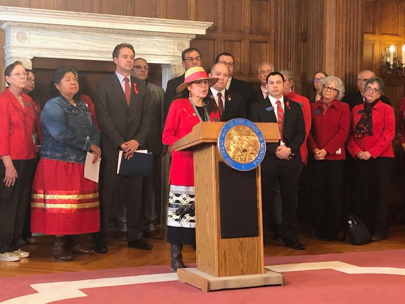 Rep. Rae Peppers, D-Lame Deer, stands at a podium in front of Gov. Steve Bullock and other proponents of Hanna's Act and HB 54 after a hearing of the House Judiciary Committee. January 30, 2019.