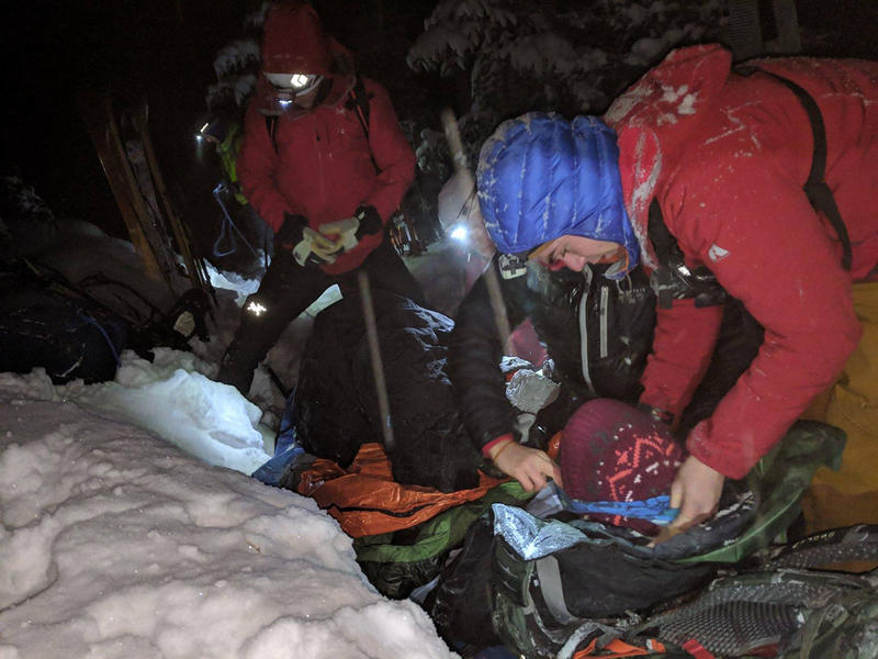Rescuers on skis locate a missing hiker near the Pioneer Falls Trail, a few miles from the Spanish Creek Cabin, Feb. 6, 2019.