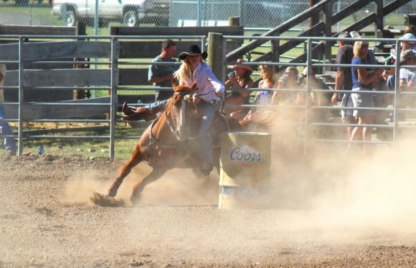 Charley Yeager competing in barrel racing