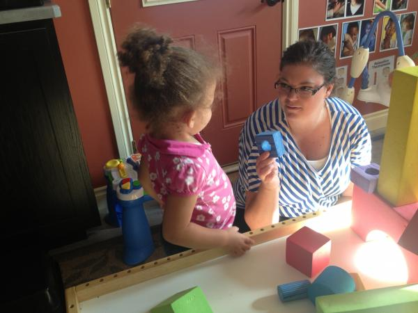 Caregiver Amanda Hatch plays with two-year-old Maya at her day care center Katerpillar Korner in Helena.